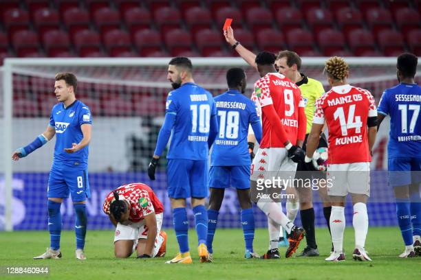 Dennis Geiger of TSG 1899 Hoffenheim is shown a red card and sent of by referee Sascha Stegemann during the Bundesliga match between 1. FSV Mainz 05...