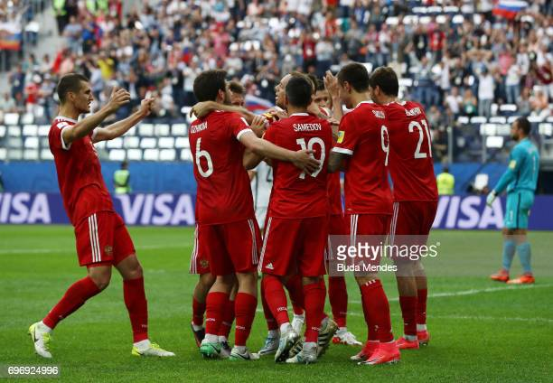 Dennis Glushakov of Russia celebrates scoring his sides first goal with his team mates during the FIFA Confederations Cup Russia 2017 Group A match...