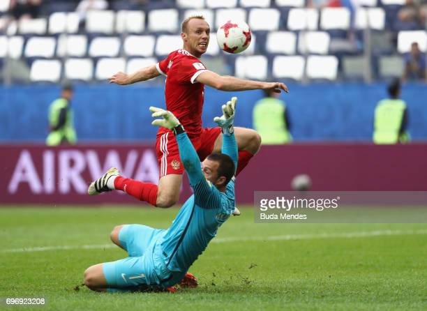 Dennis Glushakov of Russia scores his sides first goal past Stefan Marinovic of New Zealand during the FIFA Confederations Cup Russia 2017 Group A...