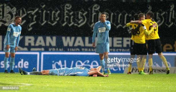 Dennis Grote and Daniel Frahn of Chemnitz look dejected after the 3Liga match between Chemnitzer FC and SC Fortuna Koeln at Community4you Arena on...