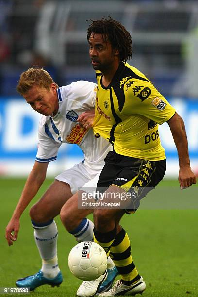 Dennis Grote of Bochum battles for the ball with Patrick Owomoyela of Dortmund during the Bundesliga match between Borussia Dortmund and VfL Bochum...