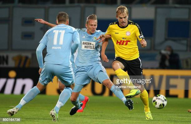 Dennis Grote of Chemnitz challenges Cimo Roecker of Koeln during the 3Liga match between Chemnitzer FC and SC Fortuna Koeln at Community4you Arena on...