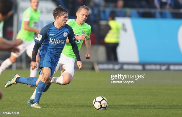 Dennis Grote of Chemnitz challenges Martin Wagner of Meppen during the 3 Liga match between SV Meppen and Chemnitzer FC at Haensch Arena on November...