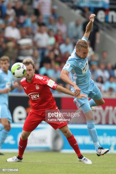 Dennis Grote of Chemnitz challenges Mike Koennecke of Zwickau during the 3Liga match between Chemnitzer FC and FSV Zwickau at community4you Arena on...