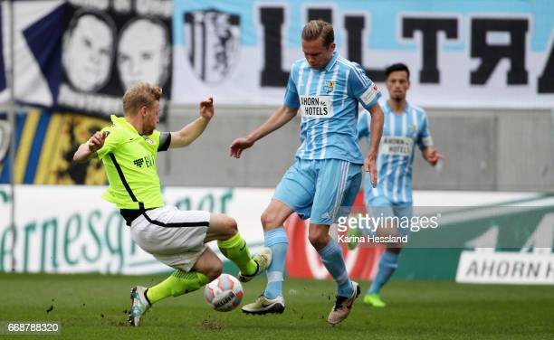 Dennis Grote of Chemnitz challenges Patrick Funk of Wiesbaden during the Third League Match between Chemnitzer FC and SV Wehen Wiesbaden on April 15...