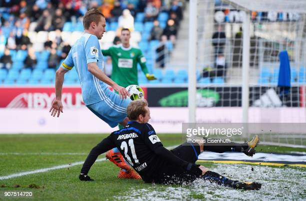 Dennis Grote of Chemnitz is challenged by Ben Zolinski of Paderborn during the 3 Liga match between Chemnitzer FC and SC Paderborn 07 at...