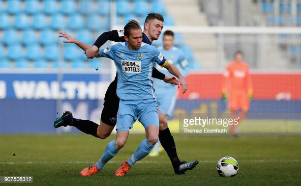 Dennis Grote of Chemnitz is challenged by Dennis Srbeny of Paderborn during the 3 Liga match between Chemnitzer FC and SC Paderborn 07 at...