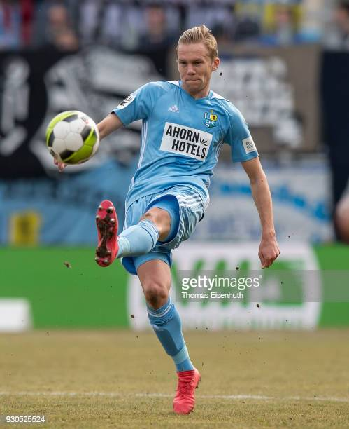Dennis Grote of Chemnitz plays the ball during the 3 Liga match between Chemnitzer FC and Hallescher FC at community4you ARENA on March 11 2018 in...