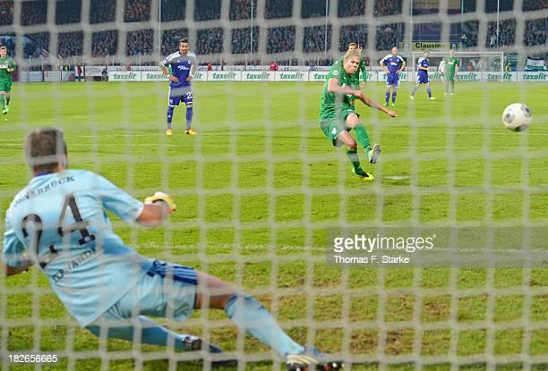 Dennis Grote of Muenster scores a penalty against goalkeeper Daniel Heuer Fernandes of Osnabrueck during the Third League match between between VfL...