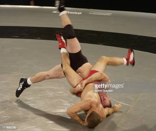 Dennis Hall of the Black Team in action against Jim Gruenwald of the Red Team in the 60kg GrecoRoman Division