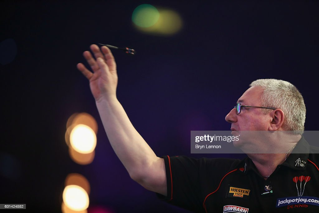 Dennis Harbour of Great Britain in action during his first round match on day four of the BDO Lakeside World Professional Darts Championships on January 10, 2017 in Frimley, England.