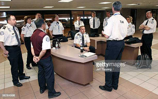 Dennis Hayne a supervisory transportation screening officer leads a meeting before a shift change of Transportation Security Administration officers...