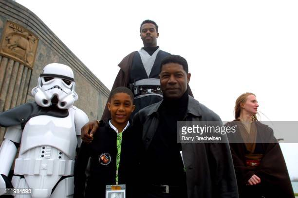 Dennis Haysbert of Fox's 24 and son Charles at Chicago's Adler Planetarium for the postscreening party