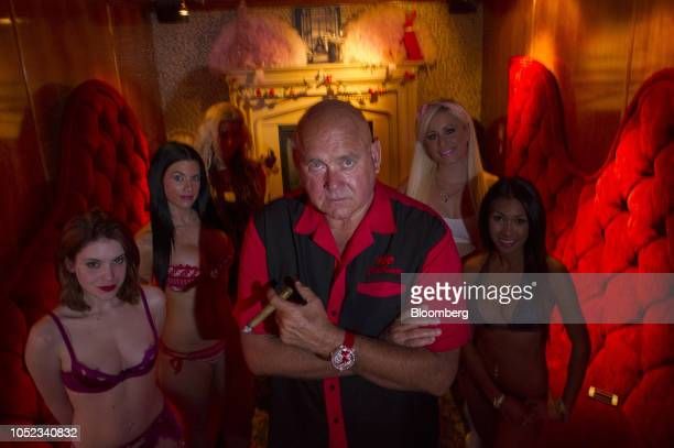 Dennis Hof owner of the Moonlite Bunny Ranch center stands for a photograph inside the Moonlite Bunny Ranch in Mound House Carson City Nevada US on...