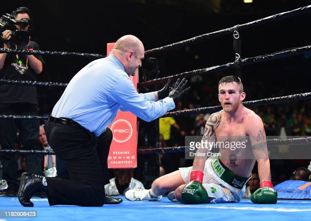 Dennis Hogan of Ireland is knocked out by Jermall Charlo of the United States during the seventh round of their WBC World Middleweight Championship...