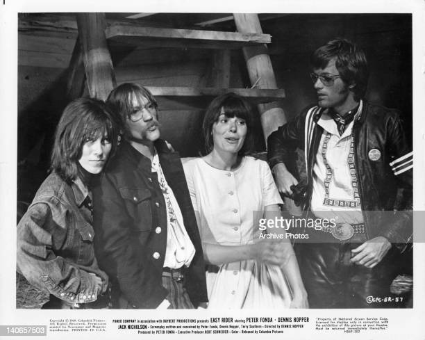 Dennis Hopper and Peter Fonda sit with others in a scene from the film 'Easy Rider' 1969