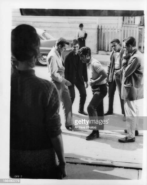 Dennis Hopper Corey Allen and others surround injured man in a scene from the film 'Rebel Without A Cause' 1955