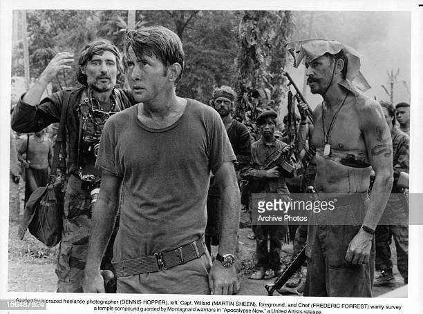 Dennis Hopper Martin Sheen and Frederic Forrest survey a temple in a scene from the film 'Apocalypse Now' 1979