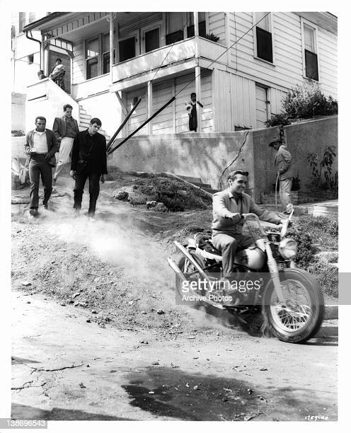 Dennis Hopper on motorcycle and members of his gang put scare into local citizens in a scene from the film 'Key Witness' 1960