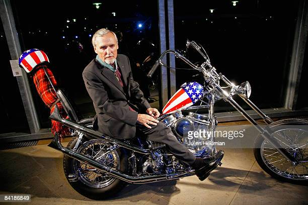 Dennis Hopper poses on the Harley Davidson he rode in the film Easy Rider after he receives the French order des Arts et des Lettres during the...