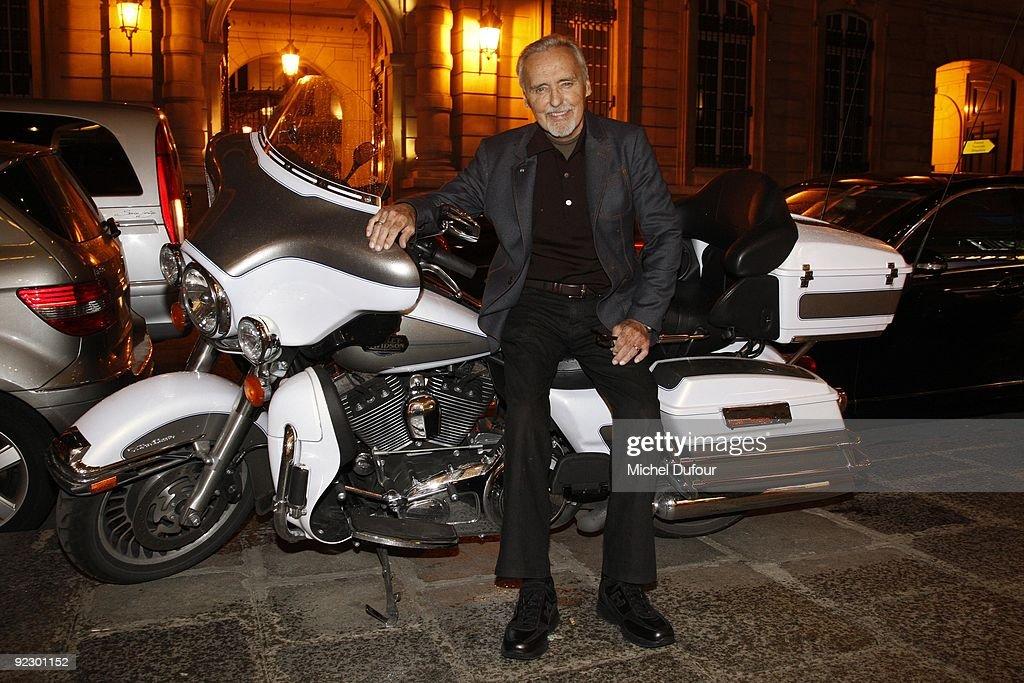 Dennis Hopper riding new Harley Davidson during his Book