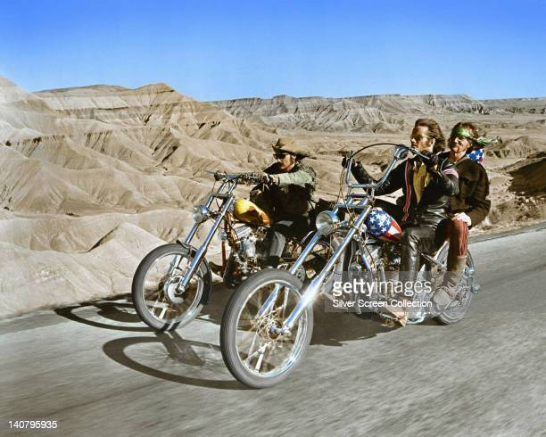 Dennis Hopper US actor and Peter Fonda US actor riding their chopper motorcycles with Luke Askew US actor on the back of Fonda's motorcycle in a...