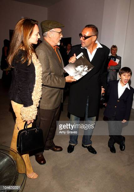 Dennis Hopper with wife Victoria Duffy and Michel Comte