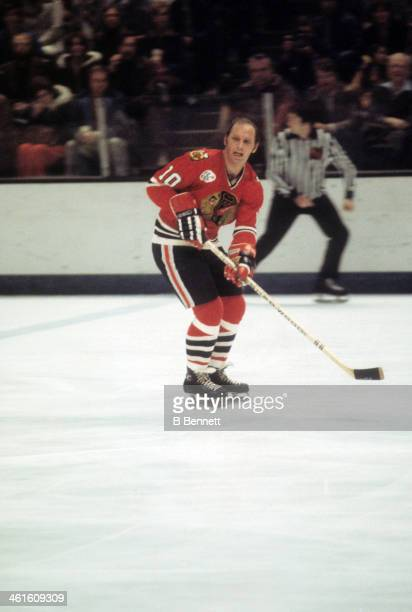 Dennis Hull of the Chicago Blackhawks skates on the ice during an NHL game against the California Golden Seals circa 1976 at the Oakland Coliseum...