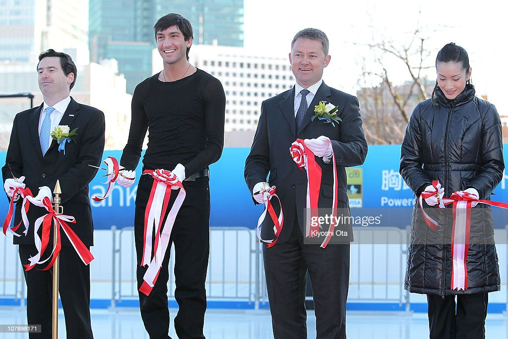 Dennis Hussey, Director and Head of Retail Banking Division of Citibank Japan Ltd., figure skater Evan Lysacek of the United States, the 2010 Vancouver Winter Olympics figure skating gold medalist, Darren Buckley, President and CEO of Citibank Japan Ltd., and figure skater Shizuka Arakawa, the 2006 Turin Winter Olympics figure skating gold medalist, cut the tape during the opening ceremony for the Citi Ice Rink at Tokyo Midtown on January 6, 2011 in Tokyo, Japan. The outdoor ice skating rink will open between January 7 and February 28.