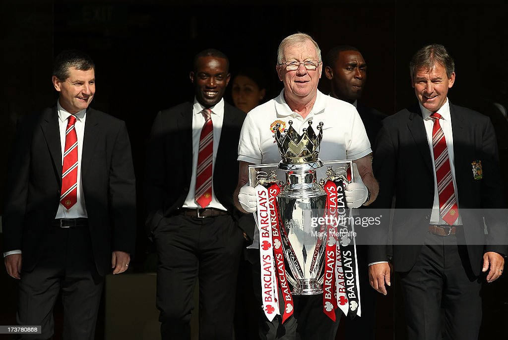 Dennis Irwin, Dwight Yorke, Andy Cole and Bryan Robson arrive with the Barclays Premier League trophy during the official Manchester United official lunch at Westin Hotel on July 18, 2013 in Sydney, Australia.