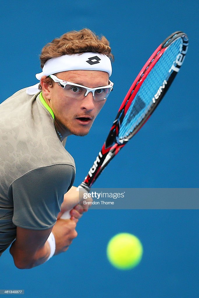 Dennis Istomin of Uzbekistan plays a backhand in his second round match against Marin Cilic of Croatia during day four of the 2014 Sydney International at Sydney Olympic Park Tennis Centre on January 8, 2014 in Sydney, Australia.