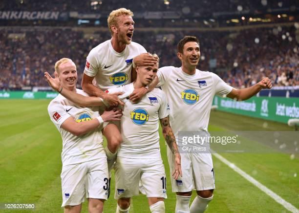Dennis Jastrzembski, Fabian Lustenberger, Ondrej Duda and Marko Grujic of Hertha BSC celebrate after scoring the 0:2 during the game between Schalke...