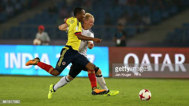 Dennis Jastrzembski of Germany battles with Andres Cifuentes of Colombia during the FIFA U17 World Cup India 2017 Round of 16 match between Colombia...