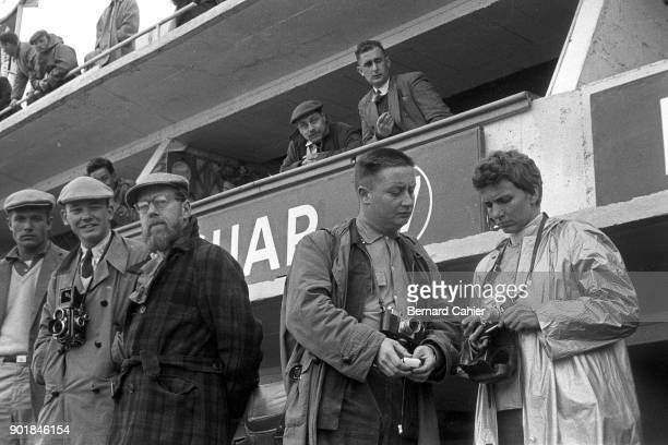 Dennis Jenkinson Yves Debraine Denise McCluggage 24 Hours of Le Mans Le Mans 06 December 1955 Famous photographer Yves Debraine expains something...