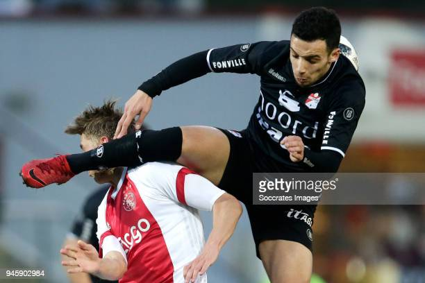 Dennis Johnsen of Ajax U23 Hilal Ben Moussa of FC Emmen during the Dutch Jupiler League match between Ajax U23 v FC Emmen at the De Toekomst on April...