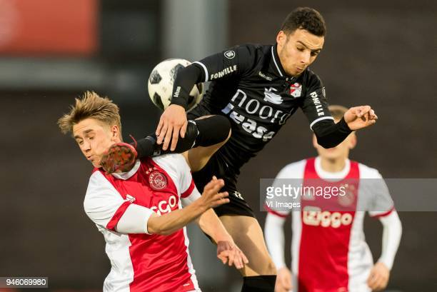 Dennis Johnsen of Jong Ajax Hilal Ben Moussa of FC Emmen during the Jupiler League match between jong Ajax Amsterdam and FC Emmen at De Toekomst on...