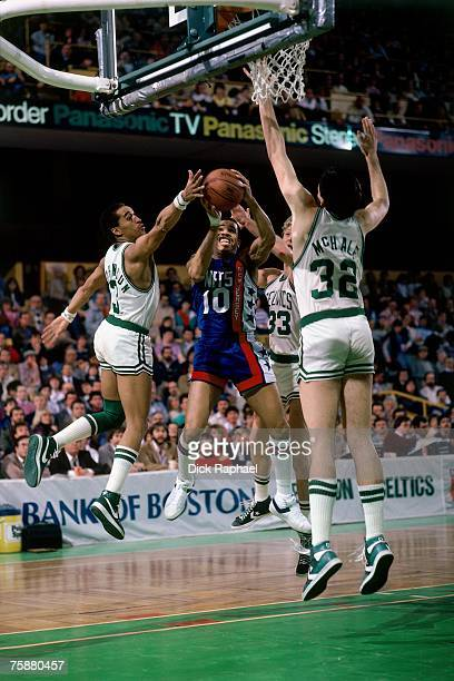 Dennis Johnson Larry Bird and Kevin McHale of the Boston Celtics defend against the New Jersey Nets during an NBA game circa 19841990 at the Boston...