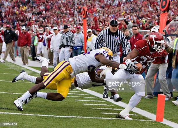 Dennis Johnson of the Arkansas Razorbacks scores a touchdown against the LSU Tigers at War Memorial Stadium on November 28, 2008 in Little Rock,...