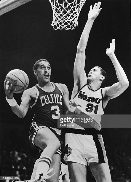 Dennis Johnson of the Boston Celtic drives for a lay up against Sam Bowie of the Portland Trailblazers during a basketball game in Portland Oregon