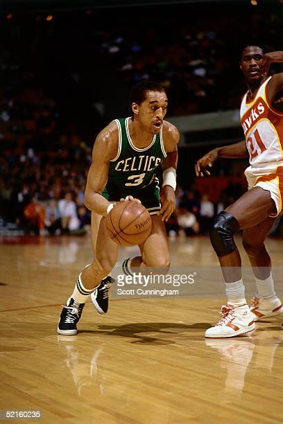 Dennis Johnson of the Boston Celtics drives to the basket against Dominique Wilkins of the Atlanta Hawks during an NBA game in 1986 at the Omni in...