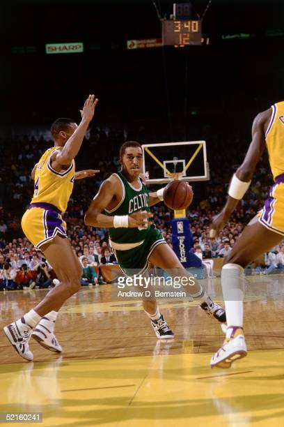 Dennis Johnson of the Boston Celtics drives to the basket against the Los Angeles Lakers during an NBA game in 1989 at the Great Western Forum in...