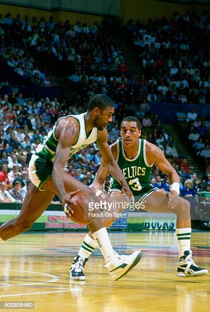 Dennis Johnson of the Boston Celtics guards Paul Pressey of the Milwaukee Bucks during an NBA basketball game circa 1986 at the MECCA Arena in...