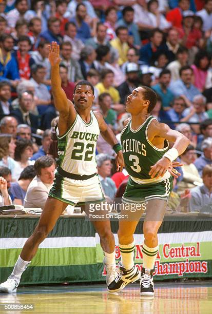 Dennis Johnson of the Boston Celtics guards Ricky Pierces of the Milwaukee Bucks during an NBA basketball game circa 1986 at the MECCA Arena in...