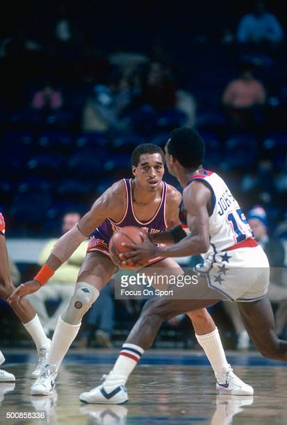 Dennis Johnson of the Phoenix Suns guards Frank Johnson of the Washington Bullets during an NBA basketball game circa 1982 at the Capital Centre in...