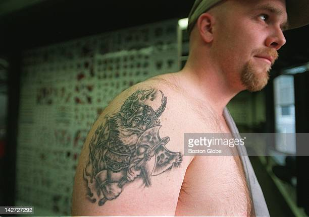Dennis Johnson who is half Norwegian shows off his Viking tattoo at Dragon's Lare in Salem NH