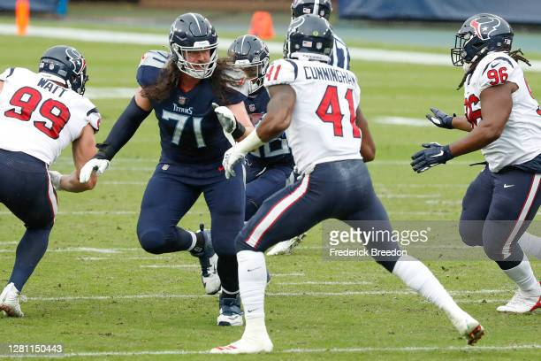Dennis Kelly of the Tennessee Titans blocks Zach Cunningham of the Houston Texans at Nissan Stadium on October 18, 2020 in Nashville, Tennessee.