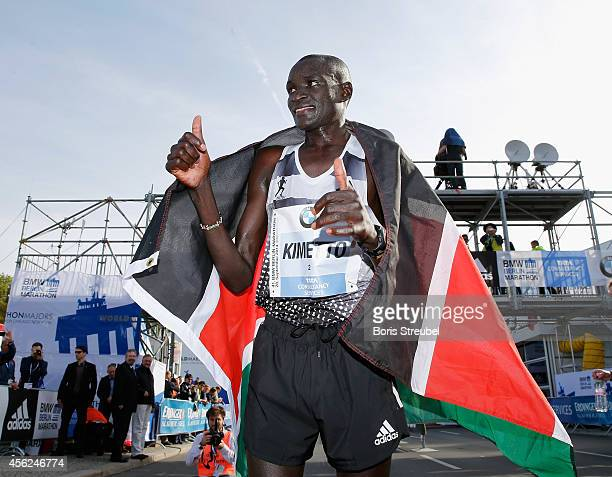 Dennis Kimetto of Kenya celebrates after crossing the finish line in new world record time during the 41th BMW Berlin Marathon on September 28 2014...