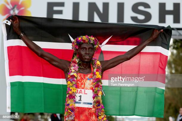 Dennis Kimetto of Kenya poses with a flag after winning the men's marathon during the Honolulu Marathon 2017 on December 10 2017 in Honolulu Hawaii