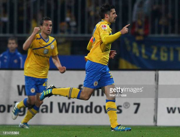 Dennis Kruppke of Braunschweig celebrates after he scores his team's equalizing goal during the Second Bundesliga match between Eintracht...