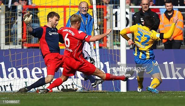 Dennis Kruppke of Braunschweig scores his team's opening goal during the Third League match between Eintracht Braunschweig and Hansa Rostock at...
